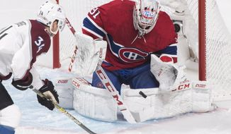 Montreal Canadiens goaltender Carey Price makes a save against Colorado Avalanche's Carl Soderberg during the first period of an NHL hockey game Saturday, Jan. 12, 2019, in Montreal. (Graham Hughes/The Canadian Press via AP)