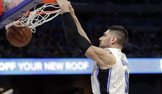 Orlando Magic's Nikola Vucevic makes an uncontested dunk against the Boston Celtics during the first half of an NBA basketball game, Saturday, Jan. 12, 2019, in Orlando, Fla. (AP Photo/John Raoux)