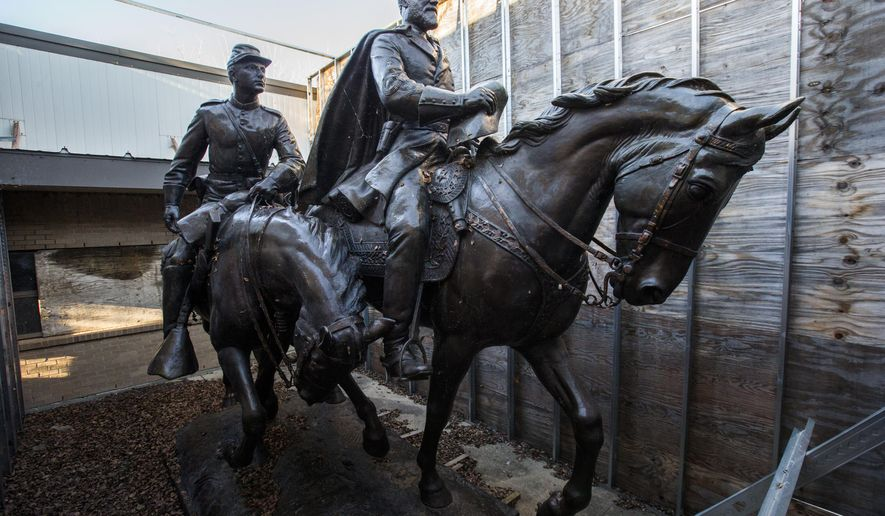 Few people have seen what became of Alexander Phimister Proctor's statue of Robert E. Lee, right, and a young soldier since its removal from the park formerly known as Lee Park, where it stood for over 80 years until it's removal in Sept. 2017. Shortly before Christmas, on Dec. 20, 2018, The Dallas Morning News got a behind-the-scenes look the secure storage area where the statue of the Confederate general is being kept at Hensley Field, the former Naval Air Station on the west side of Mountain Creek Lake in Dallas. The statue is being kept there until its future is decided. (Ashley Landis/The Dallas Morning News via AP)