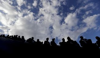 Fans watches during warm ups before an NFL divisional football playoff game between the Los Angeles Rams and the Dallas Cowboys Saturday, Jan. 12, 2019, in Los Angeles. (AP Photo/Jae C. Hong)