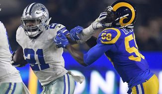 Dallas Cowboys running back Ezekiel Elliott pushes off Los Angeles Rams inside linebacker Cory Littleton during the first half in an NFL divisional football playoff game Saturday, Jan. 12, 2019, in Los Angeles. (AP Photo/Mark J. Terrill) ** FILE **