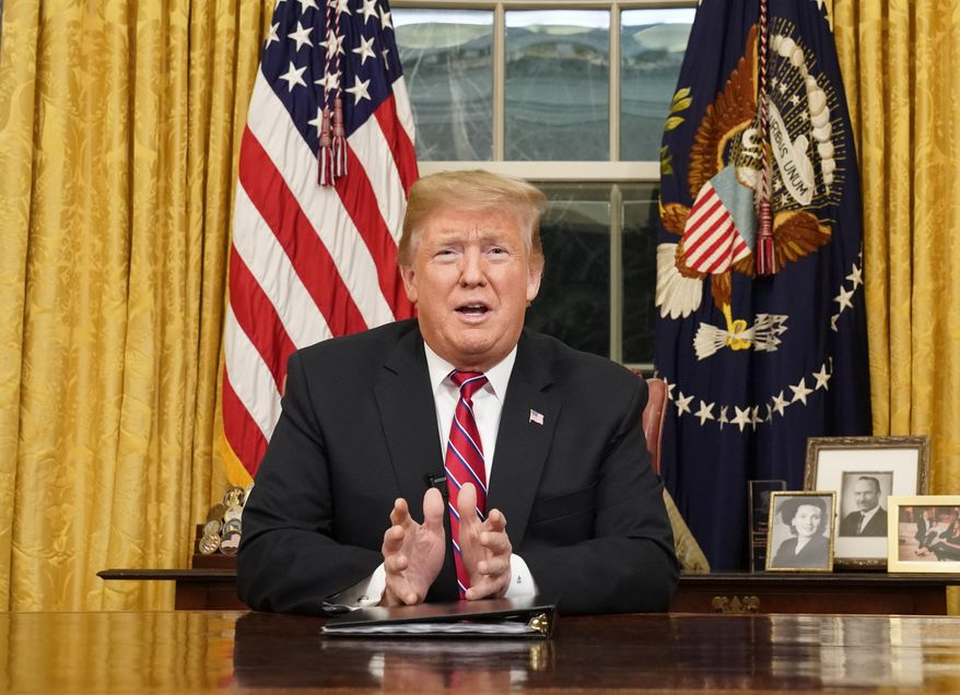 In this Jan. 8, 2019, photo, President Donald Trump speaks from the Oval Office of the White House as he gives a prime-time address about border security in Washington. (Carlos Barria/Pool Photo via AP) ** FILE **