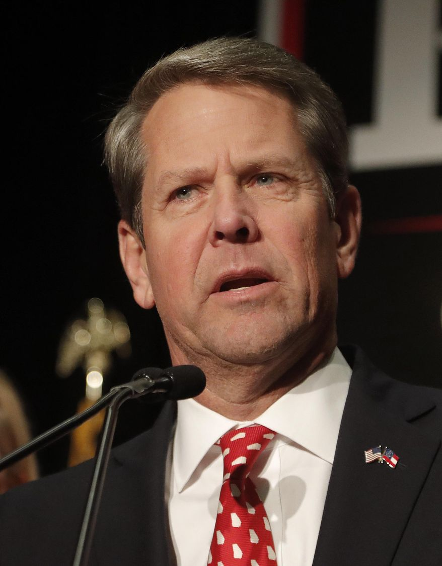 """FILE- In this Nov. 7, 2018 file photo, Brian Kemp speaks to supporters in Athens, Ga. Georgia's new governor campaigned as a self-described """"politically incorrect conservative"""" who sealed support among fellow Republicans with an endorsement from President Donald Trump and eked out a close November victory. (AP Photo/John Bazemore, File)"""
