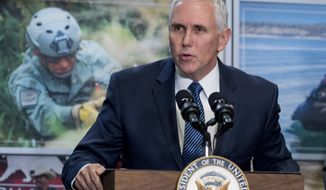 In this Jan. 11, 2019, photo, Vice President Mike Pence speaks to U.S. Customs and Border Protection employees at their headquarters in Washington. (AP Photo/Andrew Harnik)