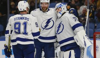 Tampa Bay Lightning's Steven Stamkos (91), Victor Hedman (77) and Louis Domingue (70) celebrate a victory over the Buffalo Sabres following the third period of an NHL hockey game, Saturday, Jan. 12, 2019, in Buffalo N.Y. (AP Photo/Jeffrey T. Barnes)