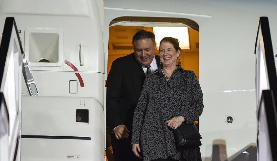 U.S. Secretary of State Mike Pompeo and his wife Susan arrive at Abu Dhabi International Airport in Abu Dhabi, United Arab Emirates, Friday, Jan.  11, 2019. (Andrew Caballero-Reynolds/Pool Photo via AP)