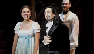 Lin-Manuel Miranda, composer and creator of the award-winning Broadway musical, Hamilton, receives a standing ovation with tears at the ending of the play's premiere held at the Santurce Fine Arts Center, in San Juan, Puerto Rico, Friday Jan. 11, 2019. The musical is set to run for two weeks and will raise money for local arts programs. (AP Photo/Carlos Giusti)