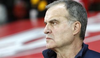 "FILE - In this Oct. 29, 2017 file photo, Marcelo Bielsa looks on during their French League one soccer match against Marseille at the Lille Metropole stadium, in Villeneuve d'Ascq, northern France. English second-tier club Leeds has been accused by a rival of having an employee spy on its training session ahead of a league match. Derby County says police were called to its training center following reports of a man ""acting suspiciously outside the premises."" Derby said the man works for the ""footballing staff at Leeds"" and that it would hold talks with Leeds. Leeds is managed by Argentine coach Marcelo Bielsa, who is known for his meticulous planning and attention to detail. (AP Photo/Michel Spingler, File)"