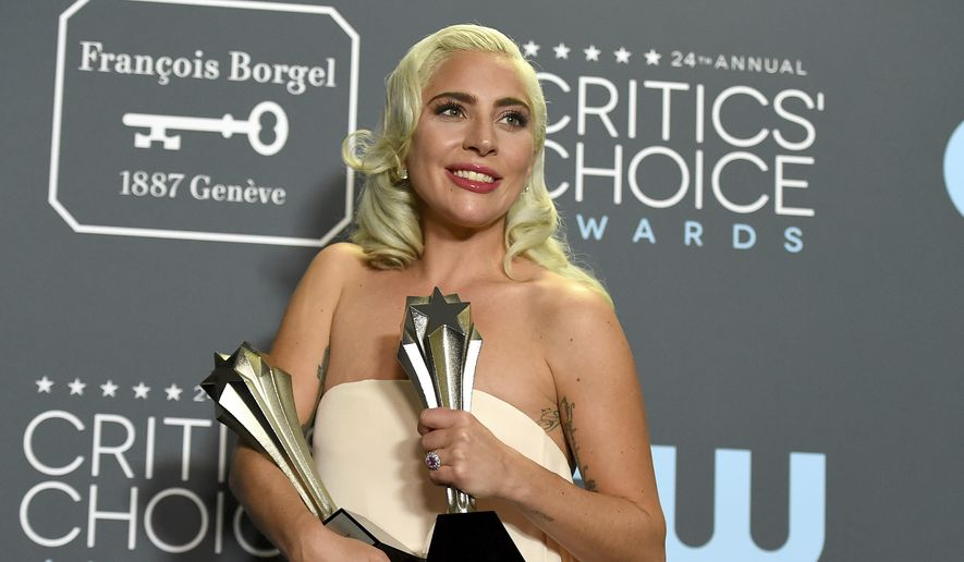 "Lady Gaga, winner of the awards for best song for ""Shallow"" and best actress for ""A Star Is Born,"" poses in the press room at the 24th annual Critics' Choice Awards on Sunday, Jan. 13, 2019, at the Barker Hangar in Santa Monica, Calif. (Photo by Jordan Strauss/Invision/AP)"