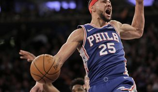 Philadelphia 76ers' Ben Simmons reacts after dunking during the first half of an NBA basketball game against the New York Knicks, Sunday, Jan. 13, 2019, in New York. (AP Photo/Seth Wenig)