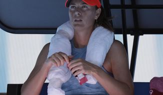 Russia's Maria Sharapova rests in her chair during her first round match against Britain's Harriet Dart at the Australian Open tennis championships in Melbourne, Australia, Monday, Jan. 14, 2019. (AP Photo/Aaron Favila)