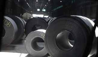 """FILE- This June, 28, 2018, photo shows rolls of finished steel at a facility in Granite City, Ill. The president frequently boasts that the taxes he's imposed on imports, steel and aluminum and nearly half of all goods from China, have showered the U.S. Treasury with newfound revenue. """"We are right now taking in $billions in Tariffs,'' President Donald Trump tweeted last month. """"MAKE AMERICA RICH AGAIN.'' Yet the fact is that tariffs like Trump's account for barely 1 percent of federal revenue. (AP Photo/Jeff Roberson, File)"""