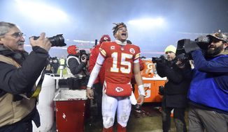 Kansas City Chiefs quarterback Patrick Mahomes (15) reacts toward fans in the stands after an NFL divisional football playoff game in Kansas City, Mo., Saturday, Jan. 12, 2019. The Chiefs defeated the Indianapolis Colts 31-13. (AP Photo/Ed Zurga)