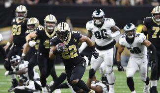 New Orleans Saints running back Mark Ingram (22) runs against the Philadelphia Eagles in the second half of an NFL divisional playoff football game in New Orleans, Sunday, Jan. 13, 2019. (AP Photo/Bill Feig) **FILE**