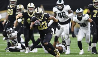 New Orleans Saints running back Mark Ingram (22) runs against the Philadelphia Eagles in the second half of an NFL divisional playoff football game in New Orleans, Sunday, Jan. 13, 2019. (AP Photo/Bill Feig)