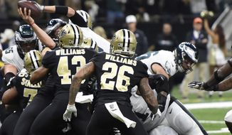 Philadelphia Eagles quarterback Nick Foles (9) leaps into the end zone for touchdown in the first half of an NFL divisional playoff football game against the Philadelphia Eagles in New Orleans, Sunday, Jan. 13, 2019. (AP Photo/Bill Feig)