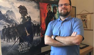 "ADVANCE FOR USE SUNDAY, JAN. 13 - in this Tuesday, Jan. 8, 2019 photo, David Andrade, of Theory Studios, poses in Orlando, Fla. Andrade has started his own small company after a career in digital animation that included work on movies like ""Blade Runner: 2049"" and ""Snow White and the Huntsman."" (Marco Santana/Orlando Sentinel via AP)"