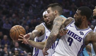 Charlotte Hornets center Willy Hernangomez, center, battles Sacramento Kings' Willie Cauley-Stein, left, and Iman Shumpert for the ball during the first quarter of an NBA basketball game Saturday, Jan. 12, 2019, in Sacramento, Calif. (AP Photo/Rich Pedroncelli)