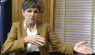 FILE - In this Dec. 17, 2018, file photo, Kansas Gov.-elect Laura Kelly answers questions during an interview with The Associated Press at the Statehouse in Topeka, Kan. Kelly was scheduled to be sworn as the state's 48th governor Monday, Jan . 14, 2019, with her inaugural address likely to stress the broad themes that underpinned her successful campaign last year. (AP Photo/John Hanna, File)