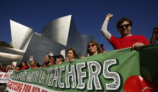 In this Saturday, Dec. 15, 2018, photo, thousands of teachers rally against the nation's second-largest school district in downtown Los Angeles. A massive teachers strike in Los Angeles is all but inevitable starting Monday, Jan. 14, 2019, after the two sides did not renew negotiations over the weekend. (AP Photo/Damian Dovarganes)