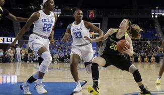 Oregon guard Sabrina Ionescu (20) drives to the basket as UCLA forward Lauryn Miller (33) and guard Kennedy Burke (22) defend during the first half of an NCAA college basketball game Sunday, Jan. 13, 2019, in Los Angeles. (AP Photo/Marcio Jose Sanchez)