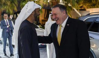 Abu Dhabi's Crown Prince Sheikh Mohammed bin Zayed Al Nahyan greets  visiting US Secretary of State Mike Pompeo prior to their meeting at Al-Shati Palace in the UAE capital Abu Dhabi on Saturday, Jan. 12, 2019.    (Andrew Caballero-Reynolds/Pool Photo via AP)