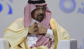 """FILE - In this Nov.12, 2018 file photo, Khalid Al-Falih, Saudi Energy and Oil Minister, speaks at the Abu Dhabi International Exhibition & Conference, in Abu Dhabi, United Arab Emirates. Al-Falih said Sunday, Jan. 13, 2019, at the Atlantic Council's Global Energy Forum in Abu Dhabi that he's not happy with the """"range of volatility"""" seen over the past two to three years. Cautious not to set a price target or range for oil, he explained there are consequences when energy prices dip too low or rise too high. (AP Photo/Kamran Jebreili, File)"""