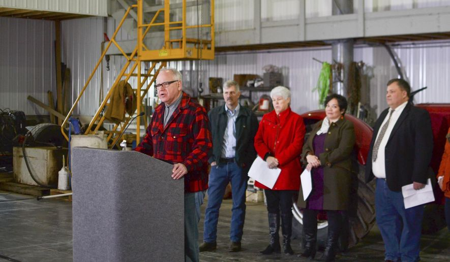 In this Jan . 3, 2019, photo provided by MinnPost, Minnesota Gov.-elect Tim Walz speaks at a news conference in Hastings, Minn. Walz, who campaigned on running a government that builds bridges among different factions, a slate of cabinet picks named recently represents his first significant foray into trying to create a delicate balancing act. (Walker Orenstein/MinnPost via AP)
