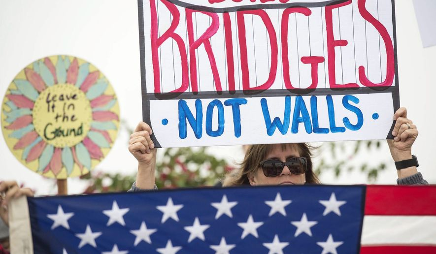A new poll reveals the gender divide on President Trump's proposed border wall with Mexico: Men favor the barrier, women don't. (Associated Press)