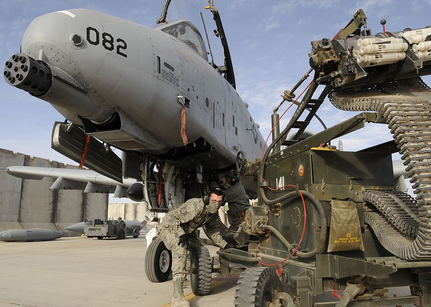 GAU 8 - Avenger 7 barrelled Gatling gun - Tech. Sgt. Patrick Hedderick and Master. Sgt. Craig May, 451st Expeditionary Aircraft Maintenance Squadron, reload the A-10 Thunderbolt II 30mm GAU-8/A Avenger Gatling gun here Feb. 11, 2010.  This is the A-10s primary built-in weapon which can hold up to 1,350 rounds of 30 mm ammunition.  (U.S. Air Force photo by Senior Airman Nancy Hooks/Released)