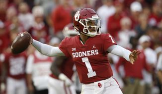 FILE - In this Sept. 22, 2018, file photo, Oklahoma quarterback Kyler Murray (1) throws in the first half of an NCAA college football game against Army, in Norman, Okla. Kyler Murray, the first-round Major League Baseball draft pick and Heisman Trophy-winning Oklahoma quarterback, says he is declaring himself eligible for the NFL draft. Murray announced his decision Monday, Jan. 14, 2019, in a tweet. (AP Photo/Sue Ogrocki, File) **FILE**