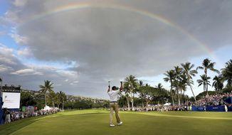 Matt Kuchar celebrates winning the Sony Open PGA Tour golf event, Sunday, Jan. 13, 2019, at Waialae Country Club in Honolulu. (AP Photo/Matt York)