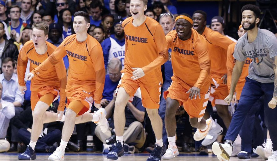 Syracuse players celebrate as time expires during overtime in an NCAA college basketball game against Duke in Durham, N.C., Monday, Jan. 14, 2019. Syracuse won 95-91. (AP Photo/Gerry Broome)