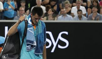 Australia's Bernard Tomic gestures as he leaves the court following his first round loss to Croatia's Marin Cilic at the Australian Open tennis championships in Melbourne, Australia, Monday, Jan. 14, 2019. (AP Photo/Kin Cheung)