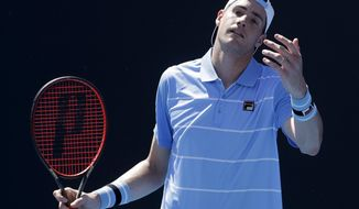 United States' John Isner reacts during his first round match against compatriot Reilly Opelka at the Australian Open tennis championships in Melbourne, Australia, Monday, Jan. 14, 2019. (AP Photo/Mark Schiefelbein)