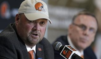 Cleveland Browns new head coach Freddie Kitchens, left, answers questions during an introductory news conference, as Browns general manager John Dorsey listens, at right, Monday, Jan. 14, 2019, in Cleveland. Kitchens helped Baker Mayfield turn his rookie season into a record-breaking one during an impressive eight-game stint as the Browns offensive coordinator. (AP Photo/Tony Dejak)