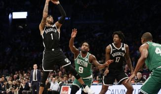 Brooklyn Nets' D'Angelo Russell (1) shoots over Boston Celtics' Brad Wanamaker (9) during the first half of an NBA basketball game Monday, Jan. 14, 2019, in New York. (AP Photo/Frank Franklin II)
