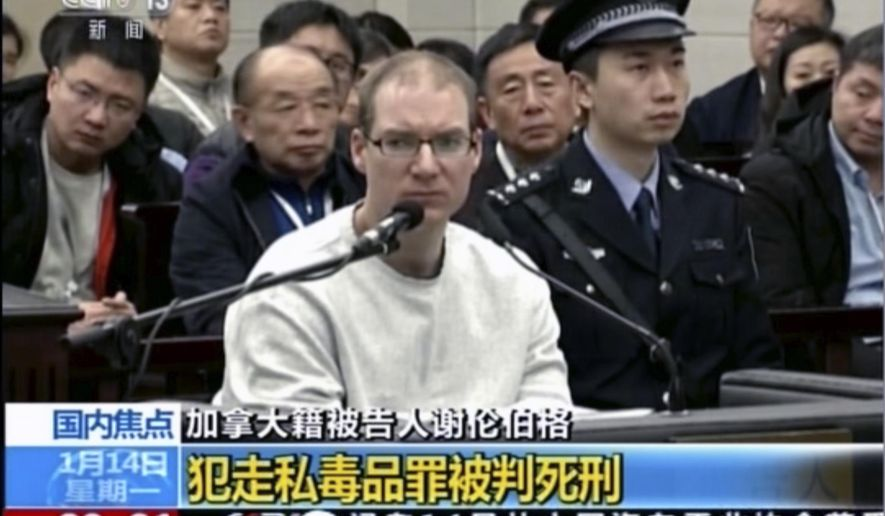 In this image taken from a video footage run by China's CCTV, Canadian Robert Lloyd Schellenberg attends his retrial at the Dalian Intermediate People's Court in Dalian, northeastern China's Liaoning province on Monday, Jan. 14, 2019. A Chinese court sentenced the Canadian man to death Monday in a sudden retrial in a drug smuggling case that is likely to escalate tensions between the countries over the arrest of a top Chinese technology executive. (CCTV via AP)