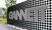 In this July 14, 2010, file photo, the Gannett Co.headquarters sign stands in McLean, Va. (AP Photo/Jacquelyn Martin, File)