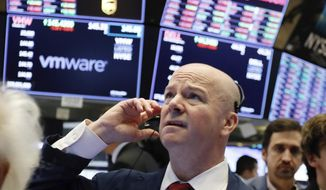 Trader Patrick Casey works on the floor of the New York Stock Exchange, Monday, Jan. 14, 2019. Stocks are opening lower on Wall Street after China reported a surprise drop in exports to the U.S. last month. (AP Photo/Richard Drew)