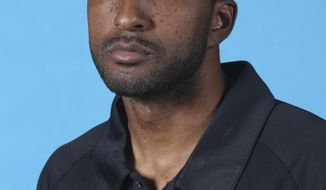 FILE - In this Sept. 28, 2009, file photo, Sacramento Kings assistant coach Shareef Abdur-Rahim poses in Sacramento, Calif. Former NBA All-Star Abdur-Rahim is starting his first full week as president of the G League. He was most recently a vice president for the NBA on its basketball operations side, and now gets to try running a league for the first time. (AP Photo/Rich Pedroncelli, File)