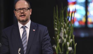 FILE - The May 4, 2016 file photo shows Gdansk mayor Pawel Adamowicz speaking at a commemoration ceremony for late Bremen Mayor Hans Koschnick. Poland's health minister says that Gdansk Mayor Pawel Adamowicz has died from stab wounds a day after being attacked onstage by an ex-convict at a charity event. (Carmen Jaspersen/dpa via AP)