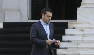 Greece's Prime Minister Alexis Tsipras, arrives to make a statement following the resignation of Defense Minister Panos Kammenos, in Athens, Sunday, Jan. 13, 2019. Kammenos, leader of the junior partner in the country's coalition government, has resigned over the Macedonia name deal, which he opposes. (AP Photo/Yorgos Karahalis)