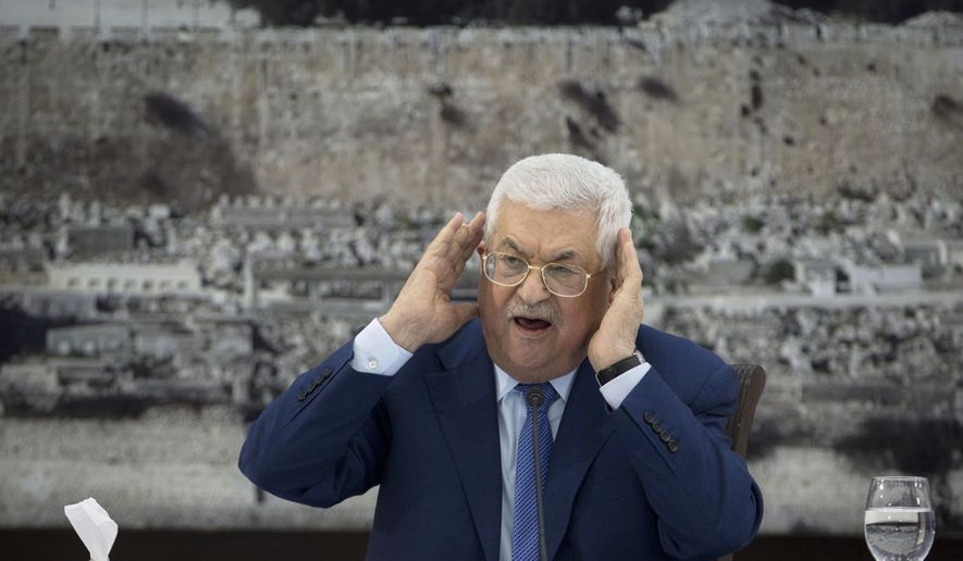 In this Dec. 22, 2018, file photo, Palestinian President Mahmoud Abbas gestures as he speaks during a meeting of the Palestinian leadership in the West Bank city of Ramallah. The Western-backed Palestinian Authority is threatening to step up pressure on Hamas amid renewed tensions in Gaza, even as Israel allows a lifeline of Qatari aid to flow directly to the Islamic militants. Abbas wants to reassert his authority over Gaza, while Israeli Prime Minister Benjamin Netanyahu seeks to preserve calm ahead of April's elections. (AP Photo/Majdi Mohammed, File)