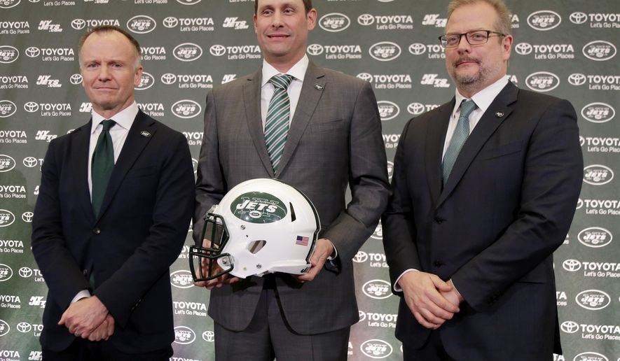 New York Jets new NFL football head coach Adam Gase, center, poses for a picture with owner Christopher Johnson, left, and general manager Mike Maccagnan during a news conference in Florham Park, N.J., Monday, Jan. 14, 2019. (AP Photo/Seth Wenig)