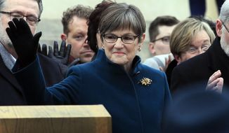 Gov. Laura Kelly stands during inaugural ceremonies on the Statehouse steps in Topeka, Kan., Monday, Jan. 14, 2019. (AP Photo/Orlin Wagner)