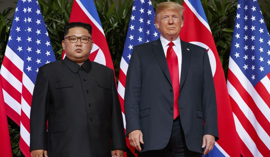 "FILE - In this June. 12, 2018, file photo, U.S. President Donald Trump, right, meets with North Korean leader Kim Jong Un on Sentosa Island, in Singapore. South Korea has stopped calling North Korea an ""enemy"" in its biennial defense document published Tuesday, Jan. 15, 2019 in an apparent effort to continue reconciliation with Pyongyang. The development comes as U.S. and North Korean leaders are looking to set up their second summit to defuse an international standoff over the North's nuclear program. (AP Photo/Evan Vucci, File)"