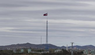 """FILE - In this April 27, 2018, file photo, a North Korean flag flutters in the wind atop a 160-meter tower in North Korea's village Gijungdongseen, as seen from the Taesungdong freedom village inside the demilitarized zone in Paju, South Korea. South Korea has stopped calling North Korea an """"enemy"""" in its biennial defense document published Tuesday, Jan. 15, 2019 in an apparent effort to continue reconciliation with Pyongyang. The development comes as U.S. and North Korean leaders are looking to set up their second summit to defuse an international standoff over the North's nuclear program. (AP Photo/Lee Jin-man, File)"""