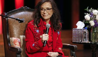 Country music legend Loretta Lynn appears on stage at the Grand Ole Opry House, Monday, Jan. 14, 2019, in Nashville, Tenn., where she announced she will celebrate her 87th birthday with an all-star tribute concert featuring Garth Brooks, Jack White, George Strait and others on April 1. (AP Photo/Mark Humphrey)