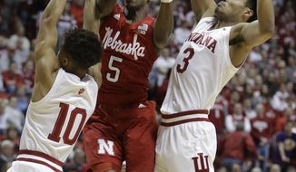Nebraska's Glynn Watson Jr. (5) puts up a shot against Indiana's Rob Phinisee (10) and Justin Smith (3) during the first half of an NCAA basketball game, Monday, Jan. 14, 2019, in Bloomington, Ind. (AP Photo/Darron Cummings)